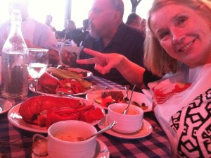 That's my wife, Nancy, enjoying her second lobster, along with Joe D'Ambrosio, the Voice of the UConn Huskies, at the 2014 clambake (Ken Davis photo)