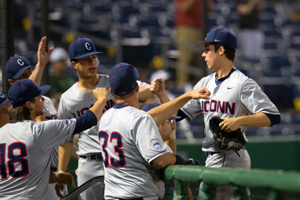 Pitcher Tim Cate congratulated by his UConn teammates (Photo: UConn Athletics)